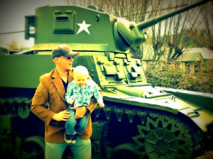 Husband and child with tank.